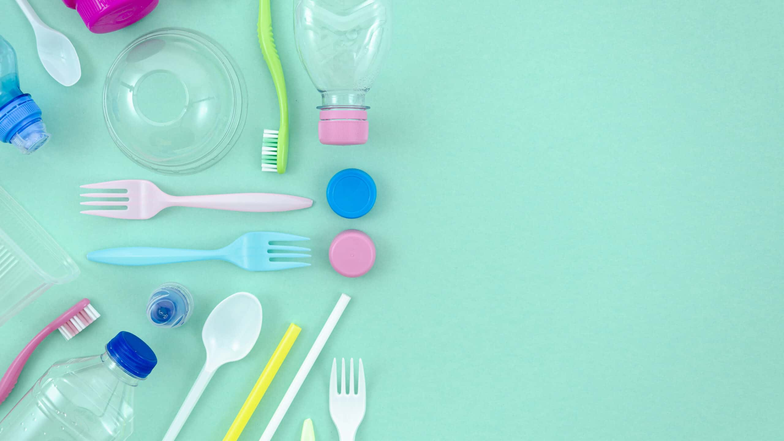 colorful-plastic-tableware-turquoise-background